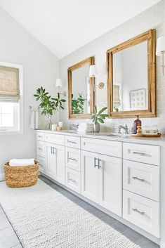 This gorgeous master bathroom is fresh and serene! Shades of grey and white are balanced with natural elements including bamboo framed mirrors, wicker baskets, and natural roman shades. Bamboo Bathroom, White Bathroom Decor, Modern Bathroom Tile, Natural Bathroom, Wood Bathroom, Grey Bathrooms, Bathroom Interior Design, Beautiful Bathrooms, Gray And White Bathroom Ideas