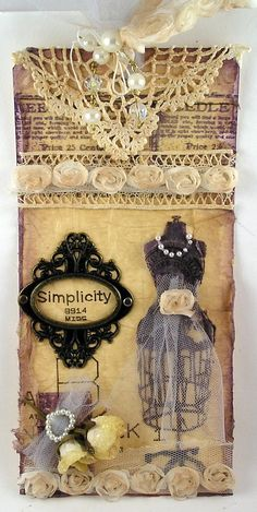 I like the vintage sewing form with chiffon skirt; pattern number clip, snippets of lace