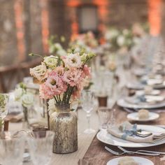 Antique gold bottle vases wedding centrepieces - long rustic Italian wedding tables