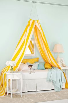 This easy DIY canopy project makes smart use of an embroidery hoop and a pair of ready-made curtains.