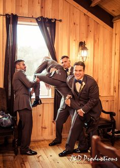 A Groom trying to jump out the window. From Cassie and Michael's Wedding at Brazos Springs in Angleton, TX.