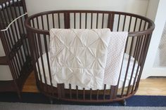 Stokke Sleepi crib in Walnut with coordinating Stokke textiles
