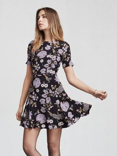 Nobody's perfect, but the Ocean Dress is pretty close. She looks great day or night, any season. This is a ghost crepe mini fit and flare dress with slightly puffed short sleeves. Fitted through the bodice and waist then the skirt kicks out. Hook/zip closure in the back. Made from 100% viscose.