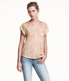 H&M V-neck top in soft jersey with short sleeves... $12.99