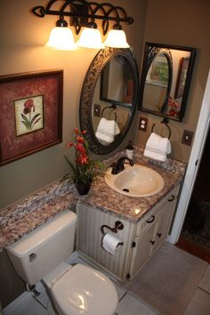 Remodel of a small bathroom. I like the continued counter top creating a shelf over the toilet.