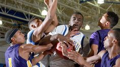 Phoebus' Harrison Mitchell fights for a rebound with Menchville's Daryl Barbour and Aquan Renault during the first half of their game Tuesday at Phoebus. (Photo by Rob Ostermaier / Daily Press)