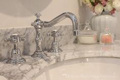 Chrome tapware & heavily veined marble on bathroom vanity (helps hide watermarks, etching) Melinda Hartwright