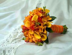 The different shades of orange adds depth to the bouquet design.
