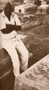 Clairvius Narcisse by the grave in Deschapelles, Haiti, where he was buried 19 years earlier.