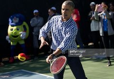 President Barack Obama plays tennis with children during the annual White House Easter Egg Roll on the South Lawn of the White House March 28, 2016 in Washington, DC. The tradition dates back to 1878 when President Rutherford B. Hayes allowed children to roll eggs on the South Lawn.