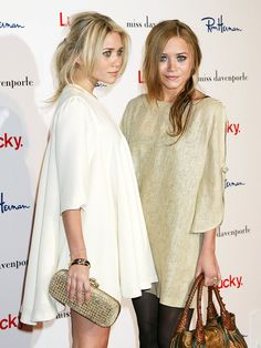Mary-Kate and Ashley Olsen in white and gold dresses