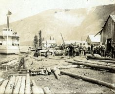 December 1897, Dawson, Yukon Territory. A steamer at dockside, men standing on the shore, and wooden buildings, some under construction, at Dawson City, Yukon Territory. F.D. Fujiwara - LC-DIG-ppmsca-08717 http://www.loc.gov #American #History #Alaska #GoldRush