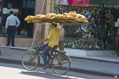 Just how much stuff can you get on a bicycle, on your head!?
