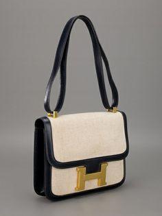 Hermès Pre-Owned 'Constance' Handbag - Farfetch Hermes Handbags, Leather Handbags, Hermes Constance, And So It Begins, Hermes Paris, Urban Outfits, Embossed Logo, Beautiful Bags, Diaper Bag