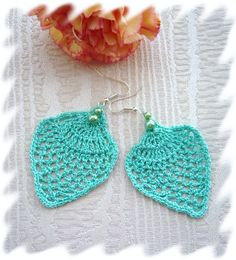 Crochet earrings   @Aimee Brown King, we should branch out into jewelry! I'd bet these are pretty easy to make!