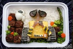 Designer Anna the Red, who specializes in bento and plush dolls, puts a fresh, geek-friendly spin on her designs. Here's adorable Pixar robot WALL-E, rendered in egg, rice, seaweed, and other materials.