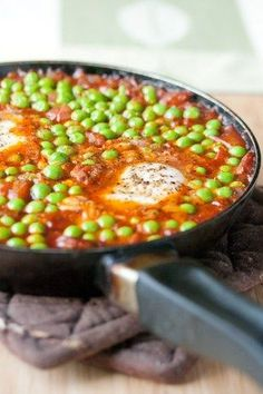 This is a humble dish. In fact, I'd say it verges on being downright homely, despite the bright pops of green peas against the brick-red sauce, the pepper-speckled egg whites and the dribble of canary-yellow yolk revealed when fork meets egg.  It's not what I'd serve if the Queen ever came over for dinner (not …