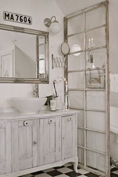 white shabby chic bathroom with a claw foot tub. If you want a space divider, just repurpose an antique French door for that