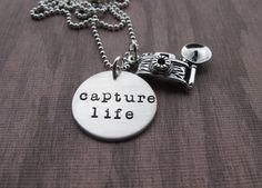 A gift for the photographer whether amateur or pro Hand Stamped Jewelry Capture Life Necklace with sterling silver flash camera charm  #capturelife #photographer @klacustom