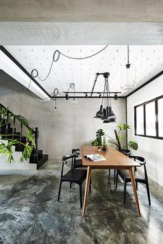 8 ideas for using concrete screed in your home, as shown in the trendy designs of these HDB flat interiors.