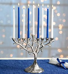 "In Hebrew, ""Etz Chaim"" means ""tree of life,"" and this beautiful tree of life menorah is the perfect Hanukkah gift to bring in the Festival of Lights!"