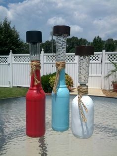 DIY patio tabletop solar lights. Empty bottle, paint, $1 solar light and jute twine