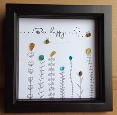 """Hand drawn framed sea glass picture, """"Bee happy"""" All the sea glass and pebble in this picture has been hand picked by myself from seaham beach, the picture has been hand drawn by myself and the seaglass glued into place to become the flowers, the bees are Yellow Sea glass which I have Bee Pictures, Pebble Pictures, Stone Pictures, Bee Happy, Shell Art, Stone Crafts, Sea Glass Crafts, Seashell Crafts, Beach Crafts"""