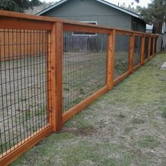I like the look and security of this fence for a dog run... just needs cedar mulch on the ground. #MyDreamBackyard