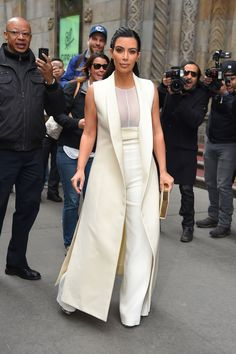 She wears an in ivory Narciso Rodriguez Fall 2015 long vest, sheer top, and high-waisted trousers look outside an event in NYC. She tops off her outfit with Giambattista Valli shoes and an Olympia Le Tan Clutch.   - MarieClaire.com