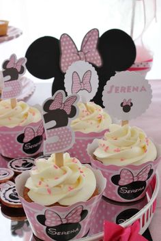Minnie Mouse birthday party cupcakes!  See more party planning ideas at CatchMyParty.com
