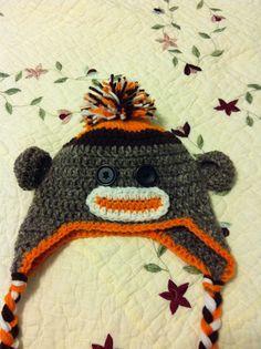 crochet sock monkey hat with pom-pom