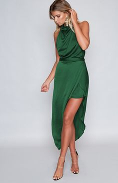 Sleek and oh so stylish, the sophisticated Monumental Dress Emerald Green is enough to make your BFFs green with envy! Made from a soft and silky green fabric, this gown features a halter neckline with three buttons on the nape, a draped cowl neck, a fitted waist and a long maxi length skirt. It also has a leg split, a tie around the waist and an invisible zipper in the back. Make style waves next cocktail night with this green goddess! Pair with diamante earrings and clear heels for a night…