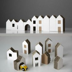 Cardboard Houses...bring out architecture school supplies we have stored for the future offspring.