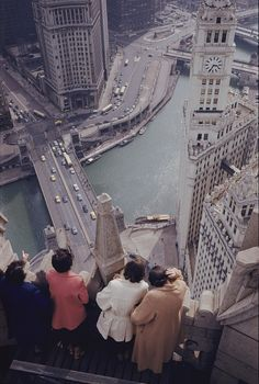 Tourists atop the Chicago Tribune building look down on the Chicago River. c. 1950s. Photograph by B. Anthony Stewart, National Geographic