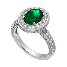 RE13959: Platinum ring with 1.06ct premium cut round diamonds and a 2.66ct emerald center stone