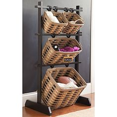 """Our WoodCrafts Basket Racks are made for every kind of room to get organized your way. Mix and match colors of our Small, Medium, or Large Hanging Baskets to add some extra flair to your home and make them work for your needs, whatever they may be. 23½""""l x 16""""w x 41""""h; Rec. Wt. Use: 40 lbs. www.Longaberger.com/LindaPanko"""