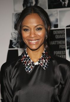 "Actress Zoe Saldana attends the premiere of ""Vantage Point"" at AMC Lincoln Square on February 20, 2008 in New York City."