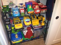 Parking garage for little boys closet. Leave room under the first shelf for those rugs with roads.