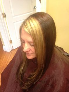 Chunky blonde around the face and brown color with red highlights in the back
