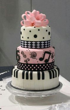 Love this cake and the colors...had lots of pink and black...a special black skirt w/ pink pianos and musical notes on it that I wore w/ a pink blouse.