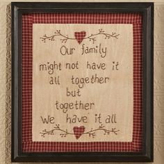 Country-style checkered border with family saying stitched in script - Our family might not have it all together but together we have it all - displayed on your wall shows the closeness of your family. Stitched piece is surrounded by a black wooden frame. http://eileenhraha.athome.com/home-decor/cornwall-county-stitchery-together-we-have-it-all.html