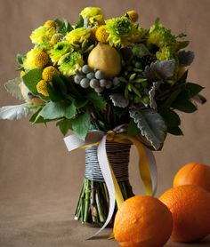 'Decorating With Lemon' http://vintagedressingroom.com/2012/09/04/decorating-with-lemon/  Bows and Arrows Bouquet - www.floralcadet.com, features lemons, ranunculus, ornamental peppers, brunia, passion vine, eucalyptus, billy balls, china berry, thistle, lamb ear, and dusty miller  bouquet of lemons, ranunculus, ornamental peppers, brunia, passion vine, eucalyptus, billy balls, china berry, thistle, lamb ear, and dusty miller