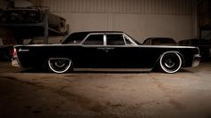 "1963 Lincoln Continental by Mobsteel with AccuAir suspension and 20"" Detroit Steel Wheel Co. rims."
