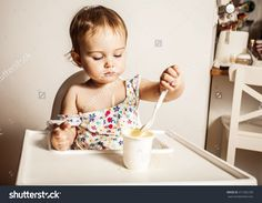 Cute Baby Girl One Year Old Eating A Yogurt By Itself. Stock Photo 311302109 : Shutterstock