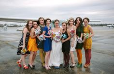 Love these bridesmaids' colorful and individual looks.