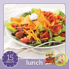 Easy Taco Salad - a healthful taco salad lunch for two was easy with a small bag of Baked! Doritos Nacho Cheese tortilla chips and preseasoned Chi-Chi's Crumbled Beef. The refrigerated seasoned ground beef has only 50 calories per 2-ounce serving.