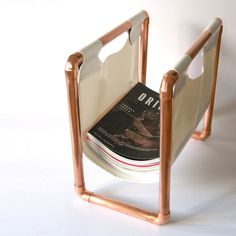 obsessed with this copper pipe magazine holder Copper Furniture, Pipe Furniture, Furniture Design, Magazine Holders, Magazine Rack, Copper Pipe Shelves, Copper Pipes, Copper Work, Le Tube