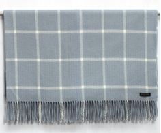 Foxford Lambswool Parma & White Windowpane Throw. A soft and luxurious architectural throw inspired by the hues in Boticelli's work.