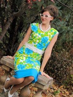 beehive, cat eye glasses, vintage dress :)