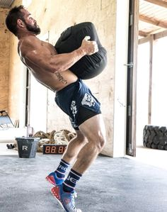 Rich Froning, the CrossFit Games Champion and owner of CrossFit Mayhem has one of the most decked-out home gyms in the world. Combining top-of-the-line Rogue Fitness Equipment with a barn makes for one amazing place to workout. Crossfit Garage Gym, Crossfit Men, Home Gym Garage, Crossfit Athletes, At Home Gym, Home Made Gym, Gym Men, Fitness Gym, Rogue Fitness
